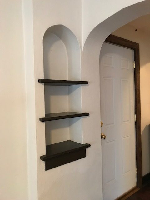 built in shelves by entrance